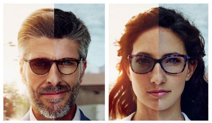 Homem e mulher usando óculos com lentes que escurecem no sol