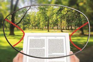 Representação da lente multifocal, cantos embaçados e meio com a imagem de um parque e um livro foco